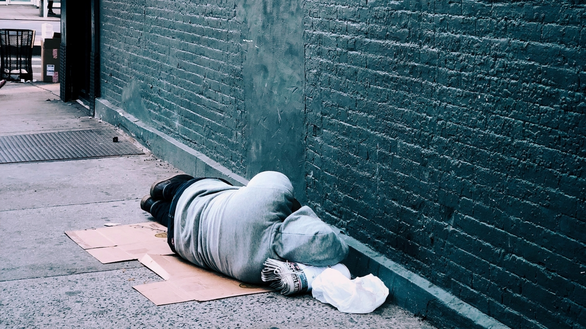 Person Experiencing Homelessness, Photo by Jon Tyson on Unsplash